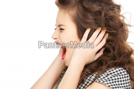 woman with hands on ears