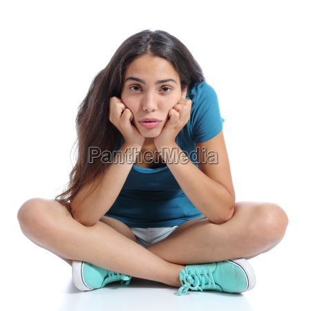 bored teenager girl sitting with crossed
