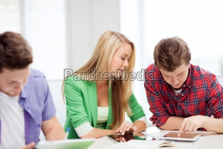 students browsing in tablet pc at