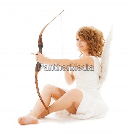 happy teenage angel girl with bow