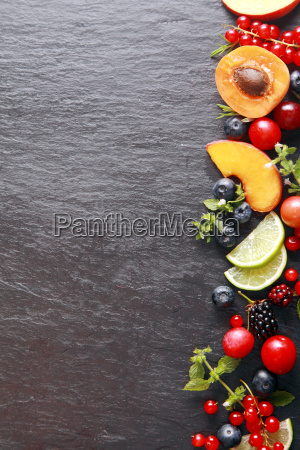 border of fresh fruit and herbs