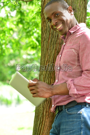 relaxed smiling man using his digital