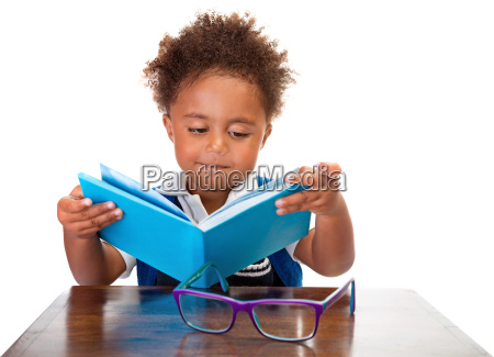 little boy reading books