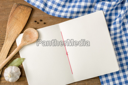 book with wooden spoons on a