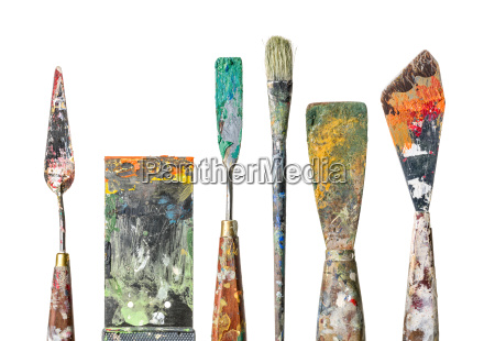 various painting spatula and brushes against