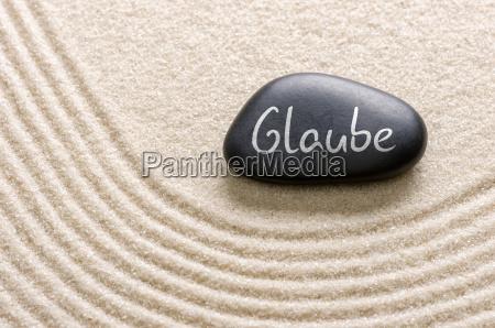 black stone labeled faith