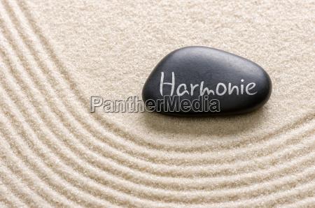 black stone with the inscription harmony