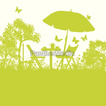 garden chairs with umbrella in the