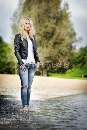 barefoot woman at lake