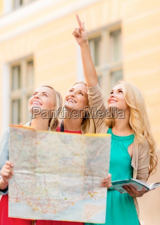 beautiful women with tourist map in