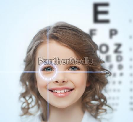 girl with eyesight testing board