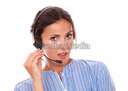 brunette operator lady speaking on headphones