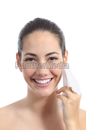 beautiful woman cleaning face with a