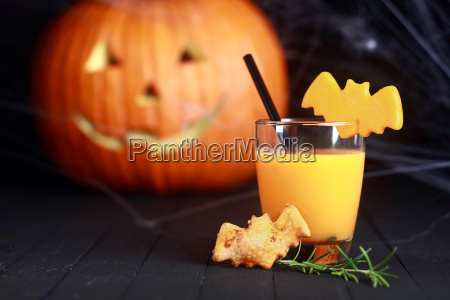 glass of orange juice decorated for