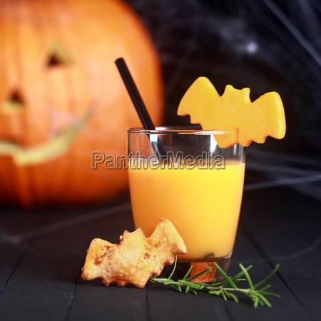 halloween orange juice with flying bats