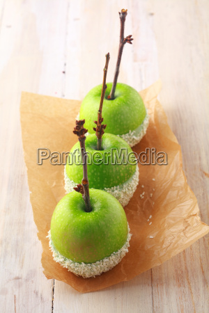 row of fresh green apples dipped
