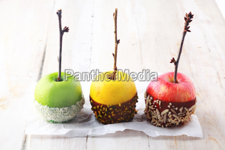 three halloween apples dipped in chocolate