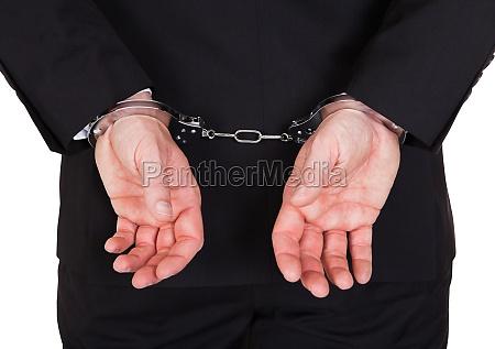 close up of arrested businessman