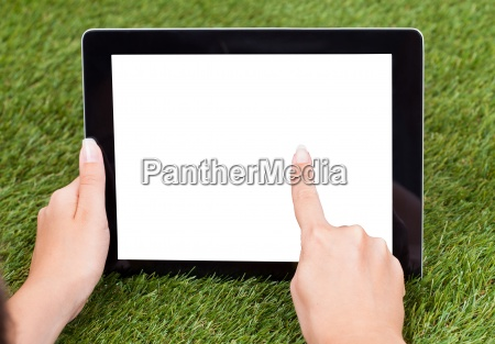 hand holding digital tablet