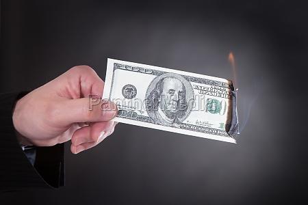 close up of hand holding burning