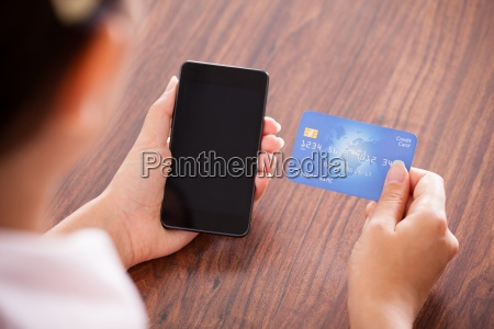 businesswoman making payment on mobile phone