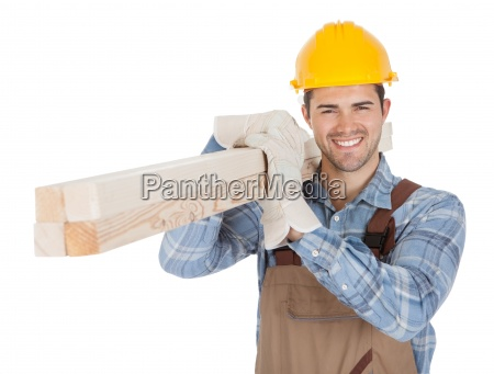 worker wearing hard hat and carrying
