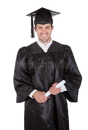 cheerful young graduation man