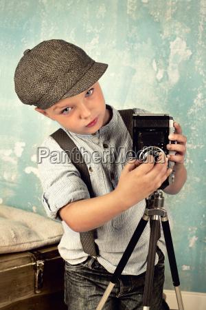 boy with camera retro look