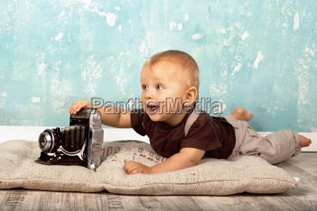 baby with retro camera