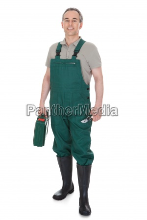 happy man holding watering can