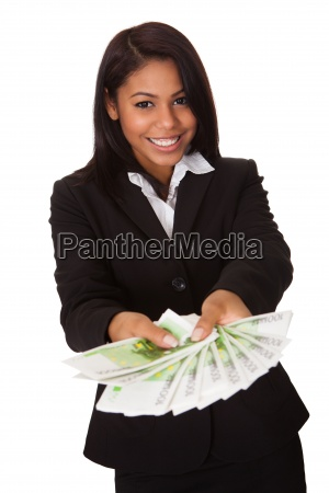 happy businesswoman holding euro note in