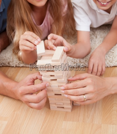 happy family playing with the wooden