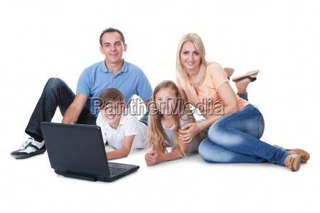 happy family with two children using