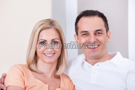 mid adult happy couple smiling together