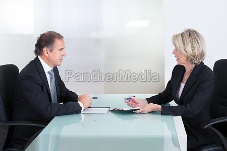 mature businessman and businesswoman