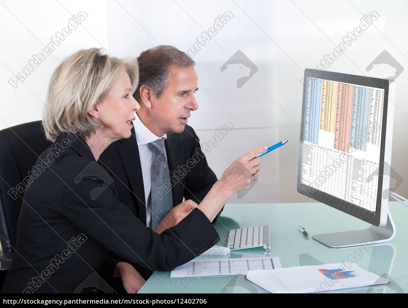 mature, businessman, and, businesswoman, looking, at - 12402706