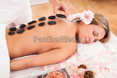 hot stones lined on her back