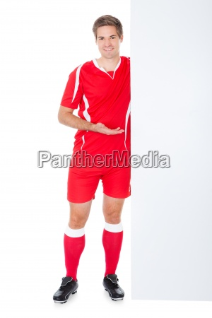 soccer player presenting placard