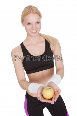 beautiful young fitness woman with apple