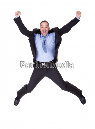 businessman jumping in joy