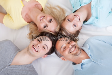 joyful family with heads together
