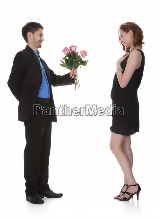 man offer flower to beautiful woman