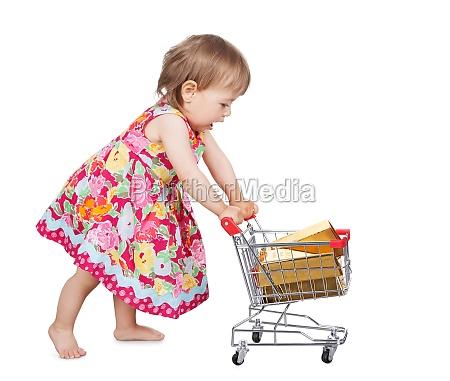 little girl pushing a trolley