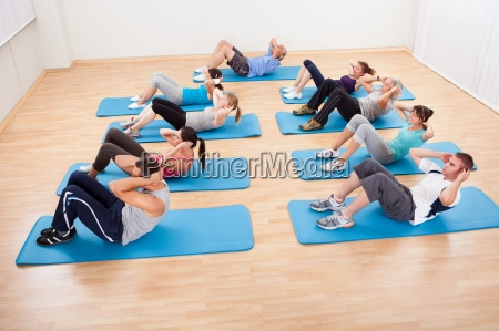 group of people working out in