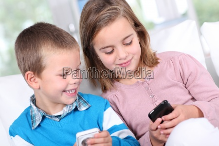 children playing with smartphone