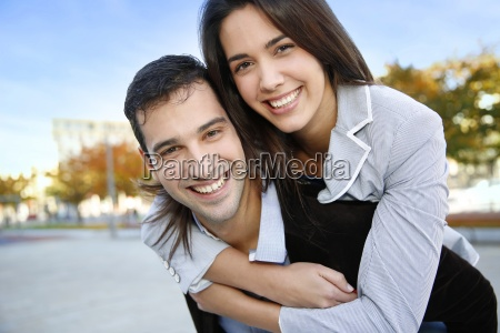 cheerful couple standing in town on