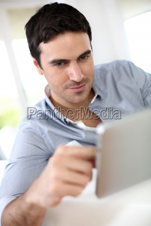 man websurfing on internet with digital