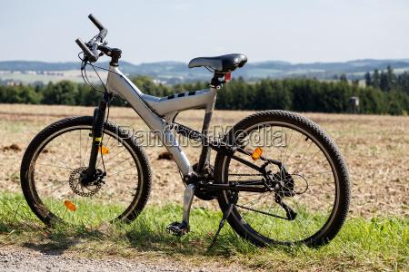 bike parked in a meadow