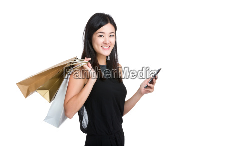 asian young woman hold mobile phone