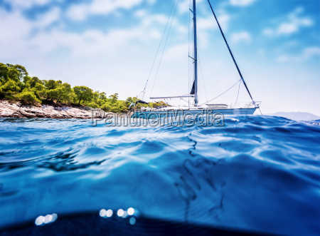 luxury sailboat near tropical island